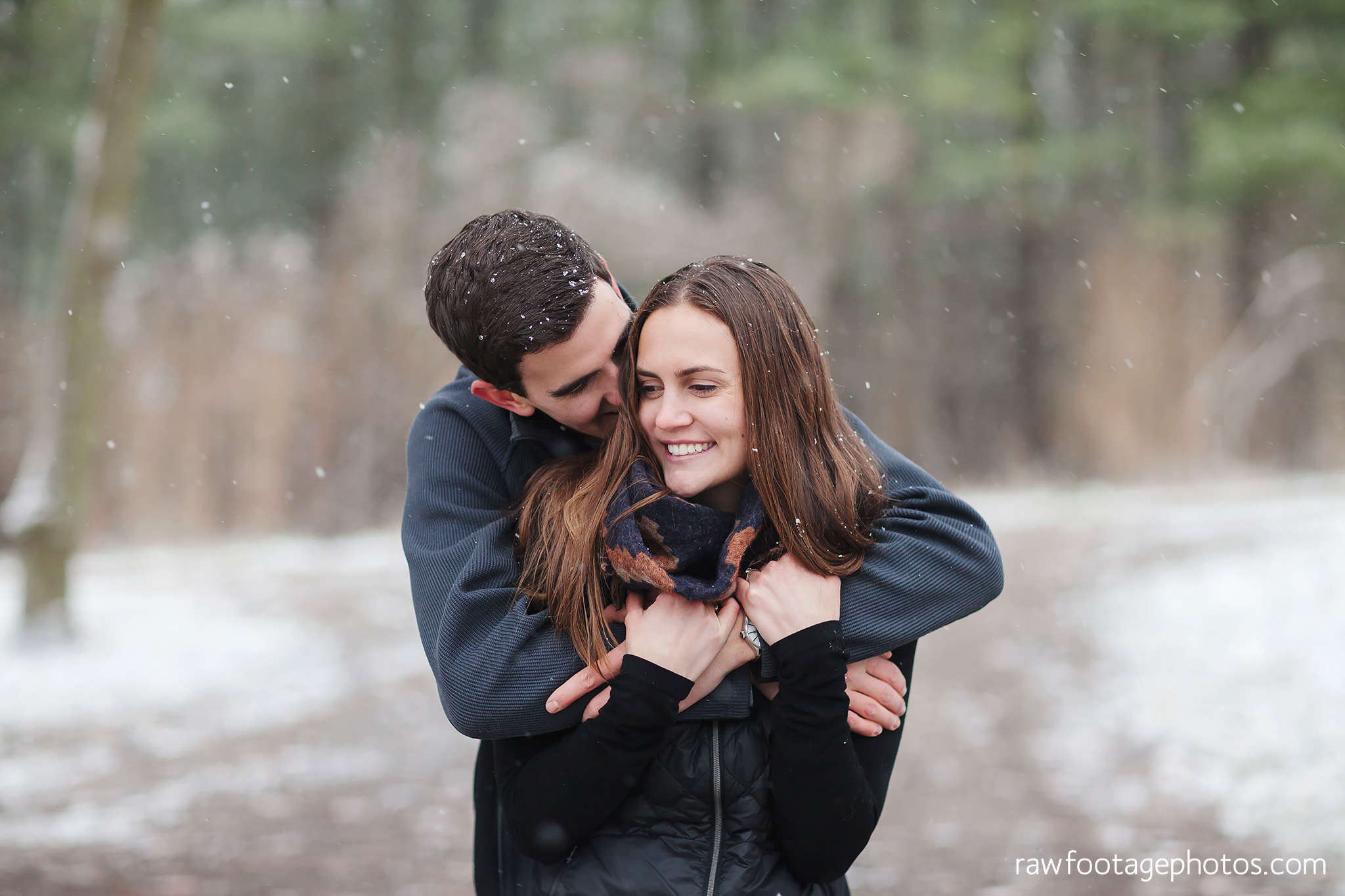 london_ontario_wedding_photographer-snowy_engagement_session-winter-barn-farm-snowflakes-blizzard-raw_footage_photography021.jpg