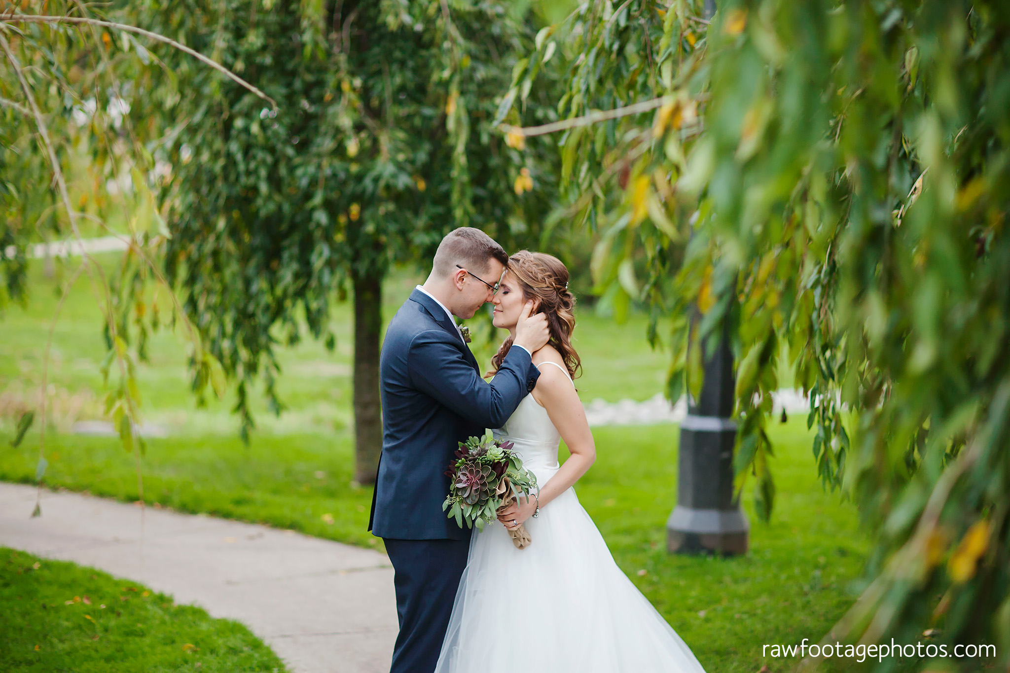 london_ontario_wedding_photographer-civic_gardens-springbank_park-succulent_bouquet-fall_wedding-bridge-raw_footage_photography056.jpg