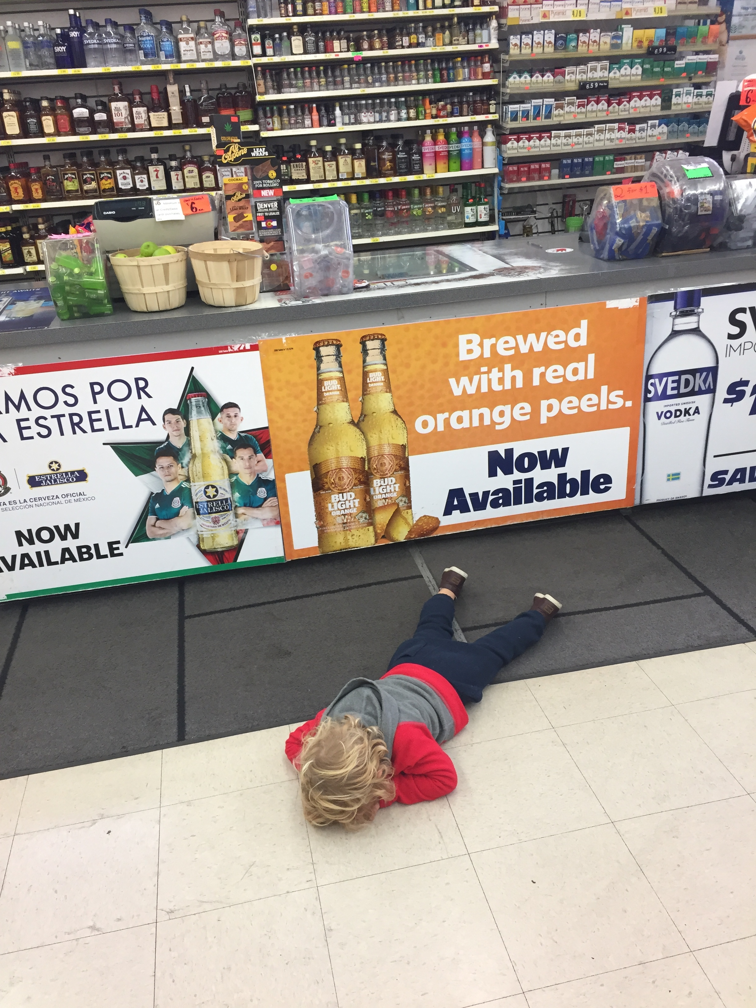 Mad because I wouldn't let him knock down all of the liquor bottles. #suchahardass