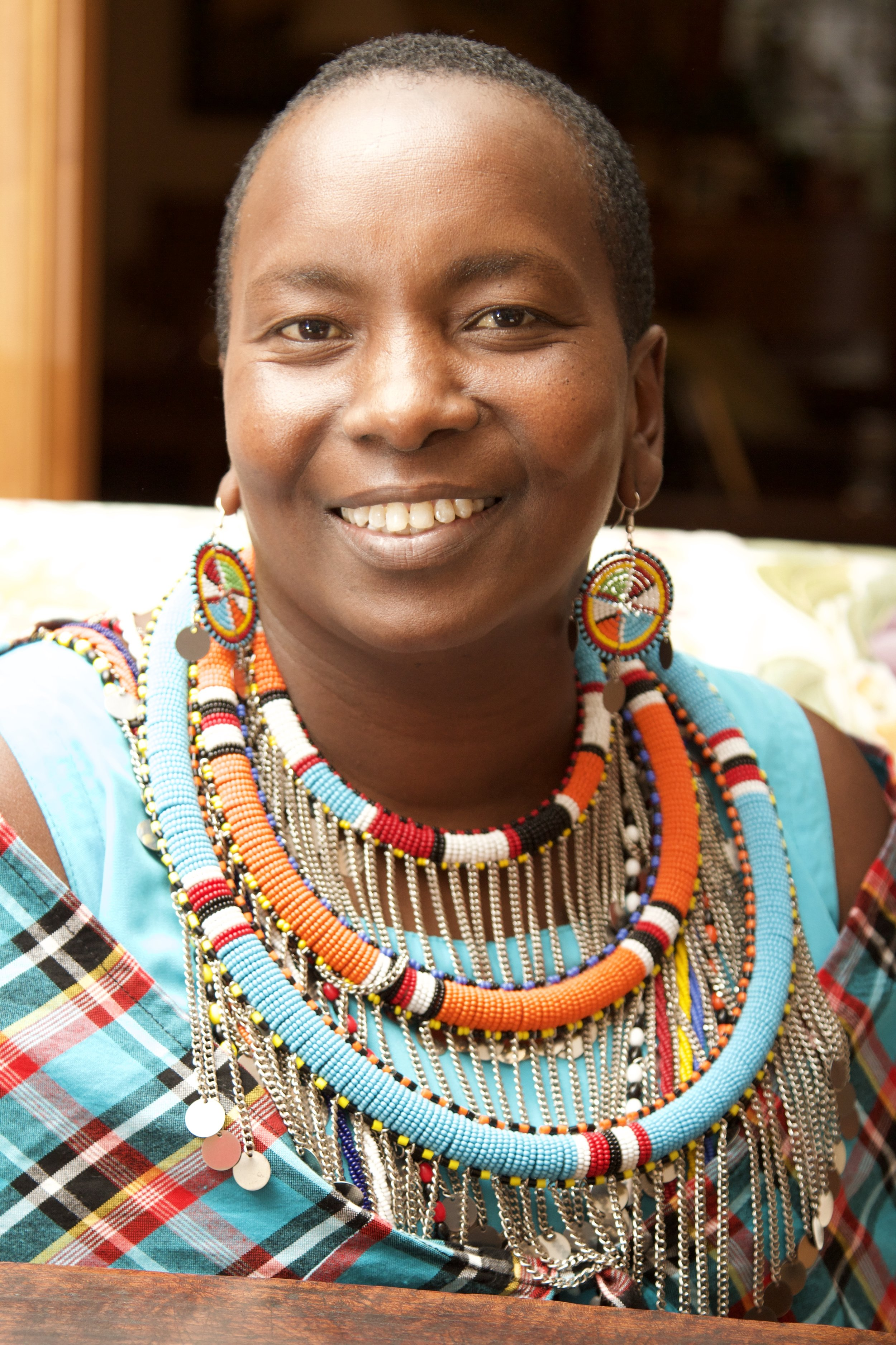 "Hellen Nkuraiya, Principal and Head Teacher of Enkiteng Lepa School - Hellen Nkuraiya's life's work is being an advocate for young girls and education in Kenya.She was born into a traditional Maasai family and was married off for cows twice by her father, starting at age nine. Hellen ran away and later received sponsorship for her higher education.In the face of family and community resistance, she has spoken publicly about her life and is a tireless advocate for girl's education and giving girls access to school. She has traveled extensively and has taken her message to countless schools, churches, and civic organizations abroad.""I have promised myself not to stop fighting for girls until my community stops exchanging girls for cows.""Hellen has taught school for 13 years, helping many young girls along the way. In 2008, in partnership with the Polish government and The Asante Africa Foundation, she founded and now serves as the Director of Enkiteng Lepa School in Maji Moto Kenya. In partnership with Jamii Moja, the school has grown to 97 students.Hellen has been instrumental in building supportive villages for widows in both Maji Moto and the village in which she now resides, Tepesua, Kenya.In 2009, Hellen was chosen and sponsored to attend the prestigious Women's Leadership for the World (WLW) program at Santa Clara University."