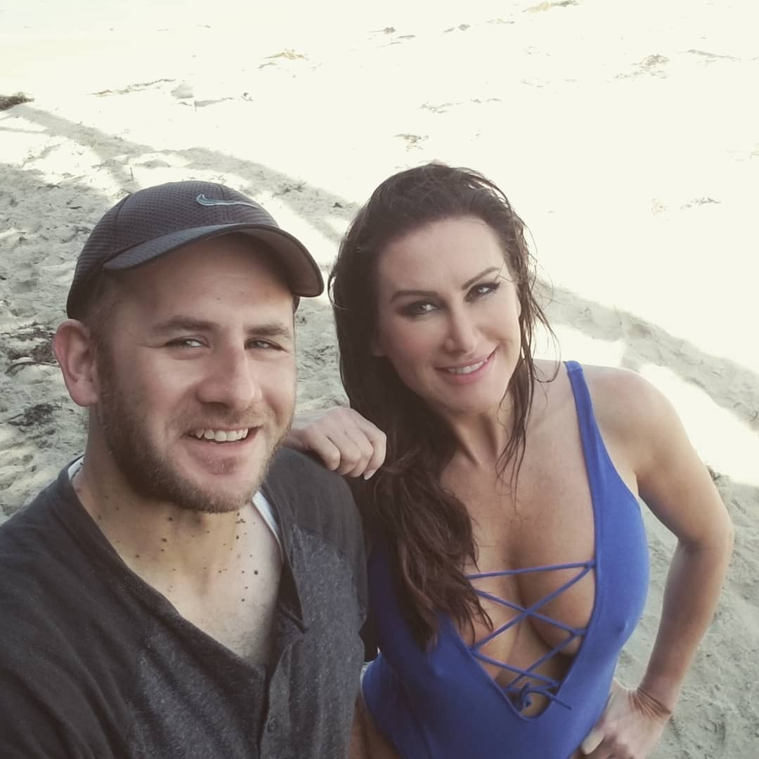 IFBB Bikini Pro Jennifer Dawn and I taking a candid shot after our photoshoot