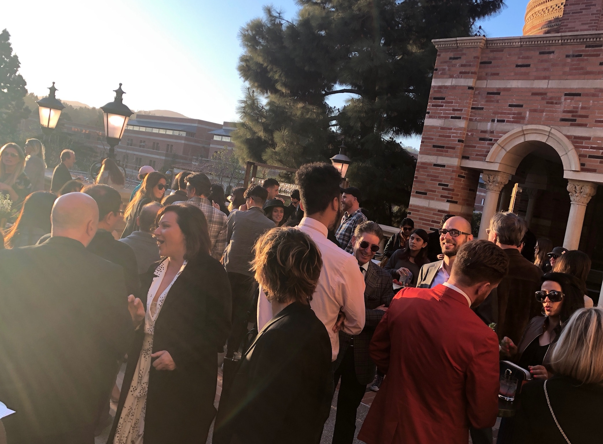 Guests mingling on the terrace of Royce Hall