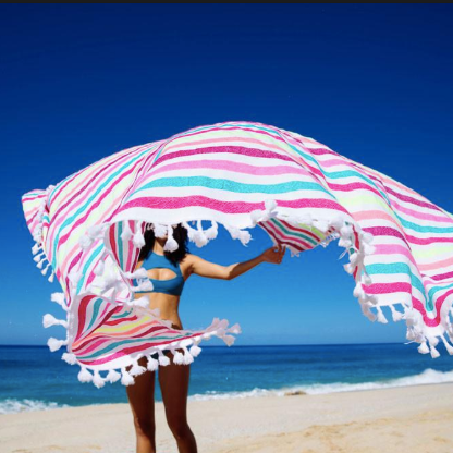 LAS BAYADAS - Lightweight beach blankets made from recycled cotton, with 10% of profits donated to support a scholarship program for local Mexican students.