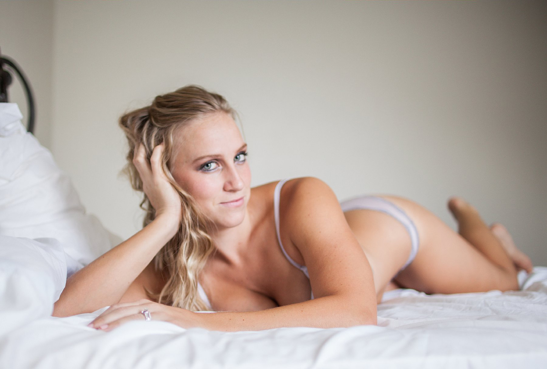 Beauty and Boudoir Photography, woman laying on white bed