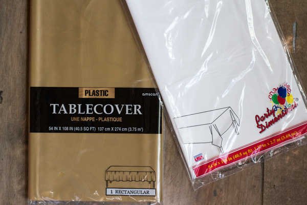 Alright, let's get started. For the fringe we used these super cheap classic plastic table covers. These are $1 each and you get 12 fringe tassels out of each table cover.