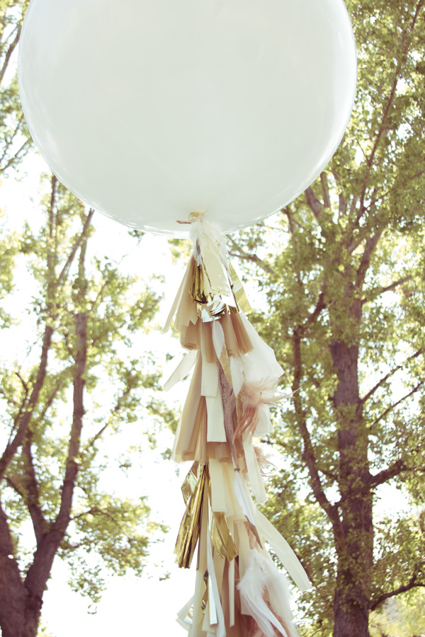 Now this is where you get creative. We added feathers to our balloons. You could easily add colorful ribbon as well. It just makes the balloon even more special.