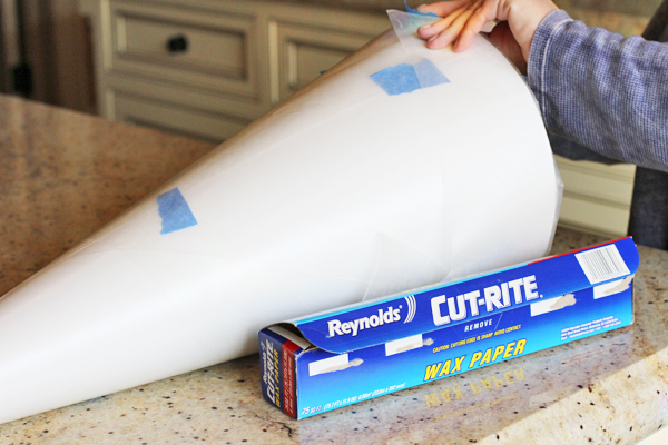 Now wrap your cone with wax paper. This is going to come out of the piñata when we are done.