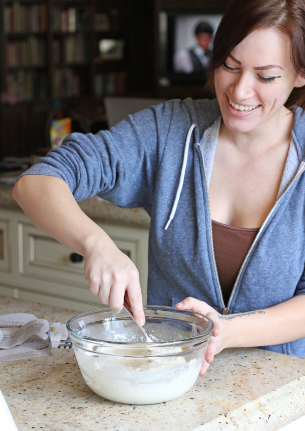 Now in a large mixing bowl (or paper bowl - even better) create your glue.  This is Sheena. She works here. She's an excellent piñata glue maker : )  Combine regular white flour with water until you have a semi-thick glue. Should be the consistency of thin yogurt.