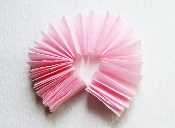 Bring the pinwheel around till the ends meet. You are going to glue the ends together.