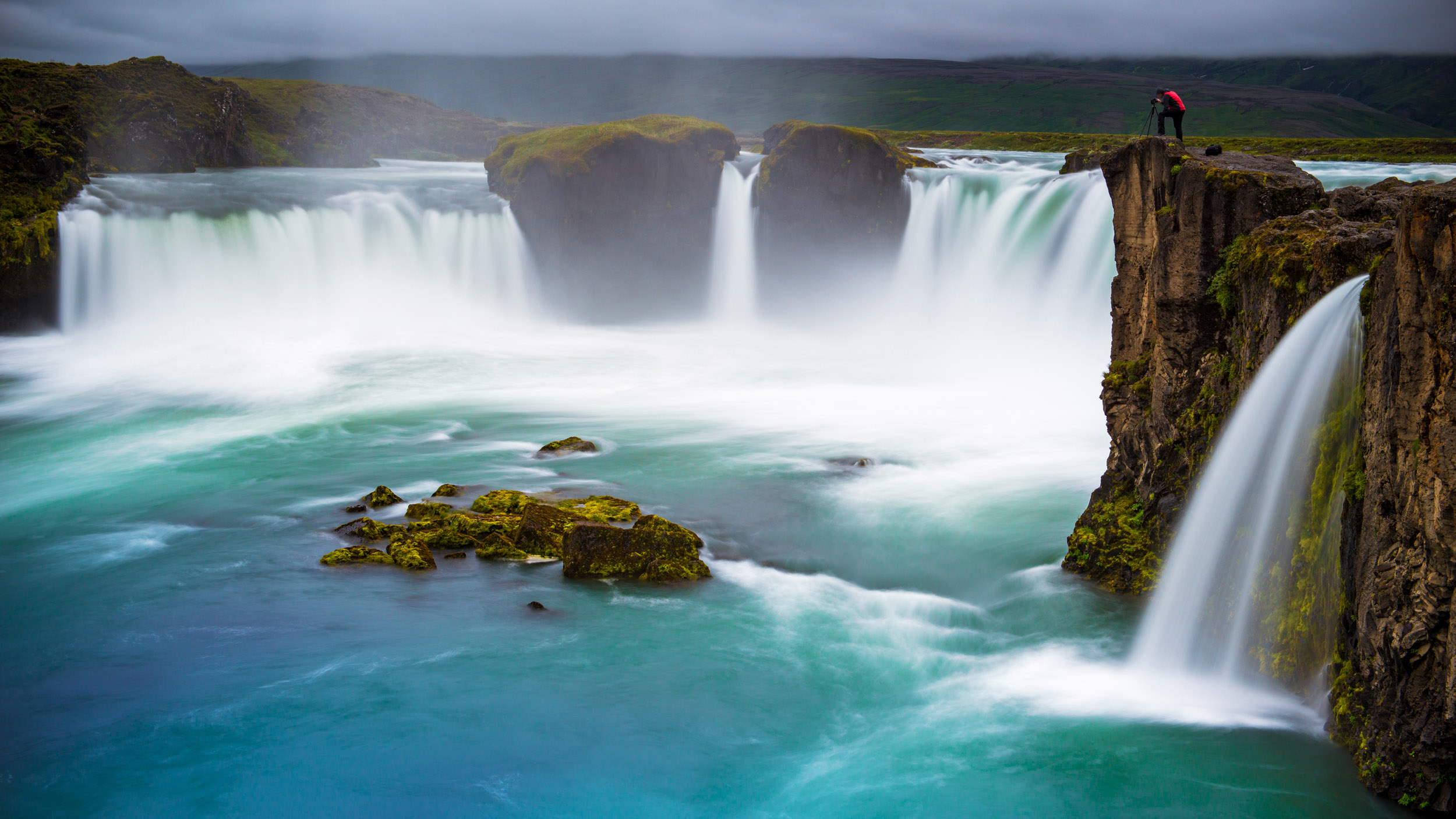 Goðafoss - The 'waterfall of the gods' in Northern Iceland. This was a gorgeous location even on a foggy day, and I managed to capture my friend photographing the location. Adding a person into the shot gives it a great sense of scale!