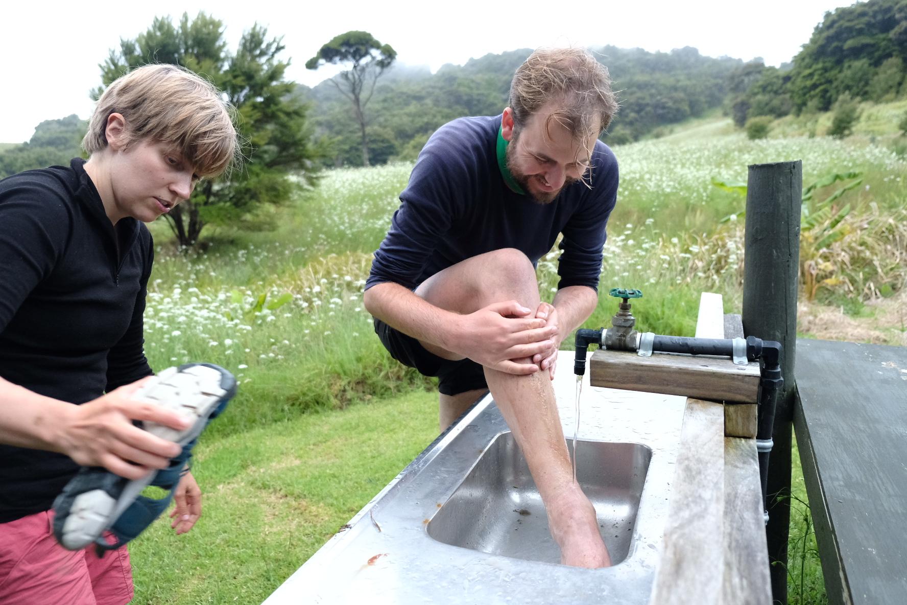 Washing the Tauharuru mud off the legs