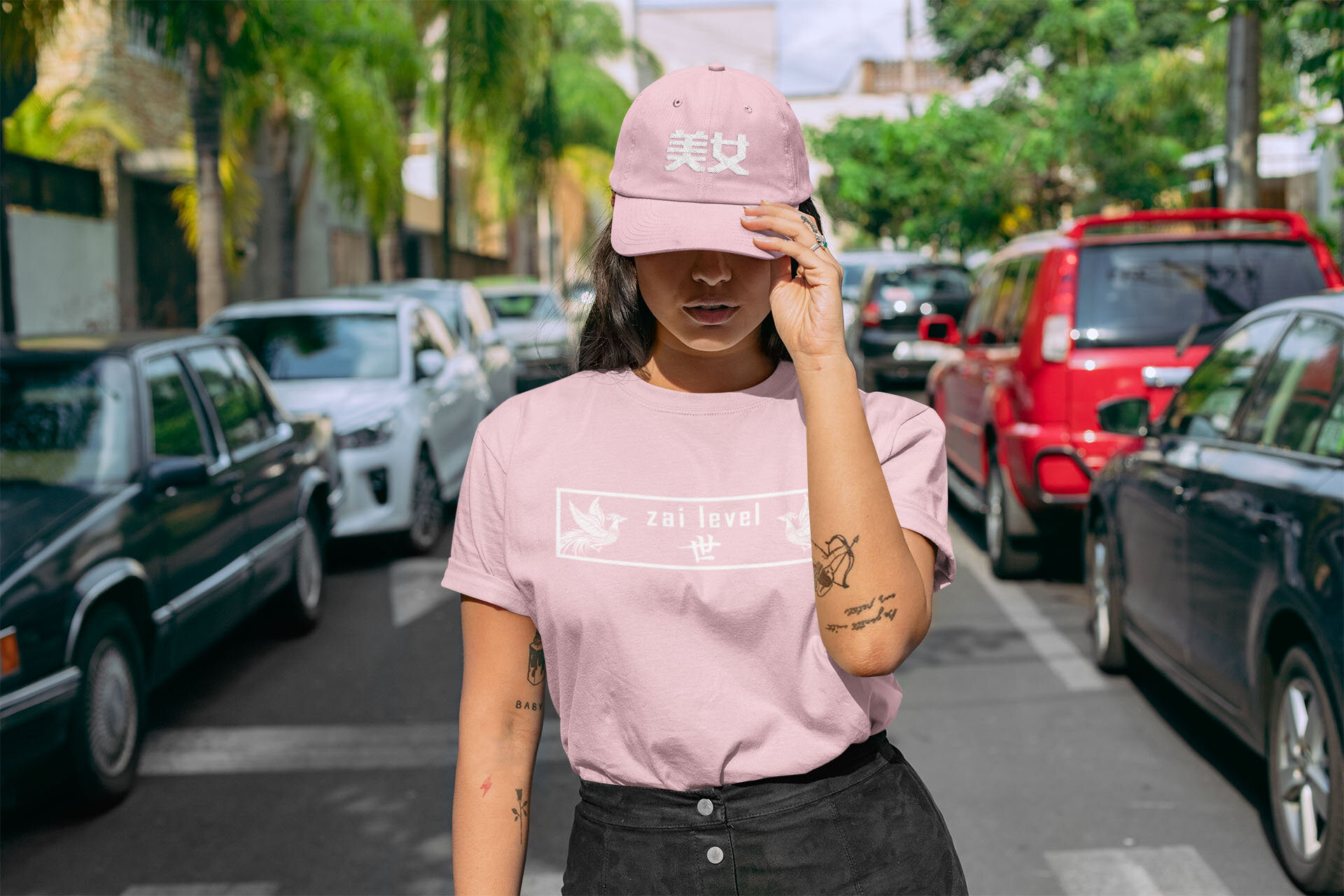 mockup-of-a-woman-standing-in-the-street-wearing-a-t-shirt-and-a-dad-hat-28608.jpg