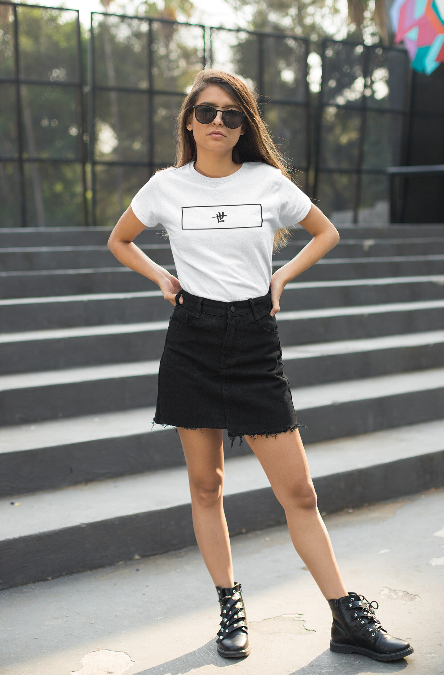 t-shirt-mockup-of-a-woman-with-sunglasses-standing-by-a-set-of-stairs-27329.jpg