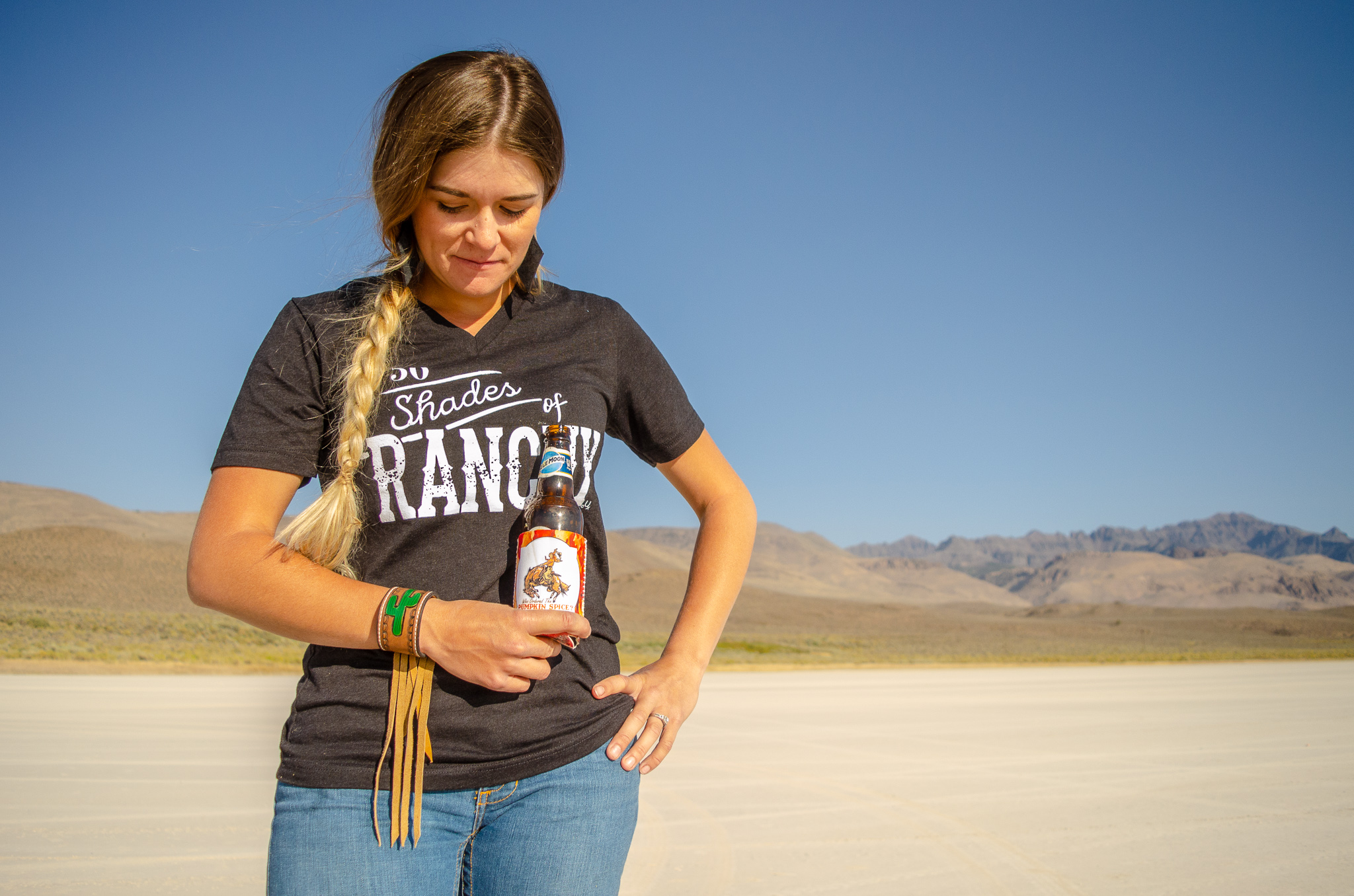 50 Shades of Ranchy  tee and koozie by U Spur. Cactus Fringe Cuff by JL Custom Leather and Beadwork.