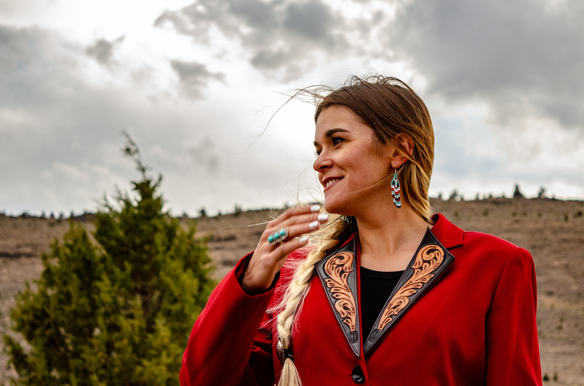 Tooled blazer, ring and hair concho by The Rustic Ranch. Beaded earrings by Flyin' A Custom Leather and Beading. Model is Morgan Kromm. Photography is by Jessica Hedges, Branded in Ink.