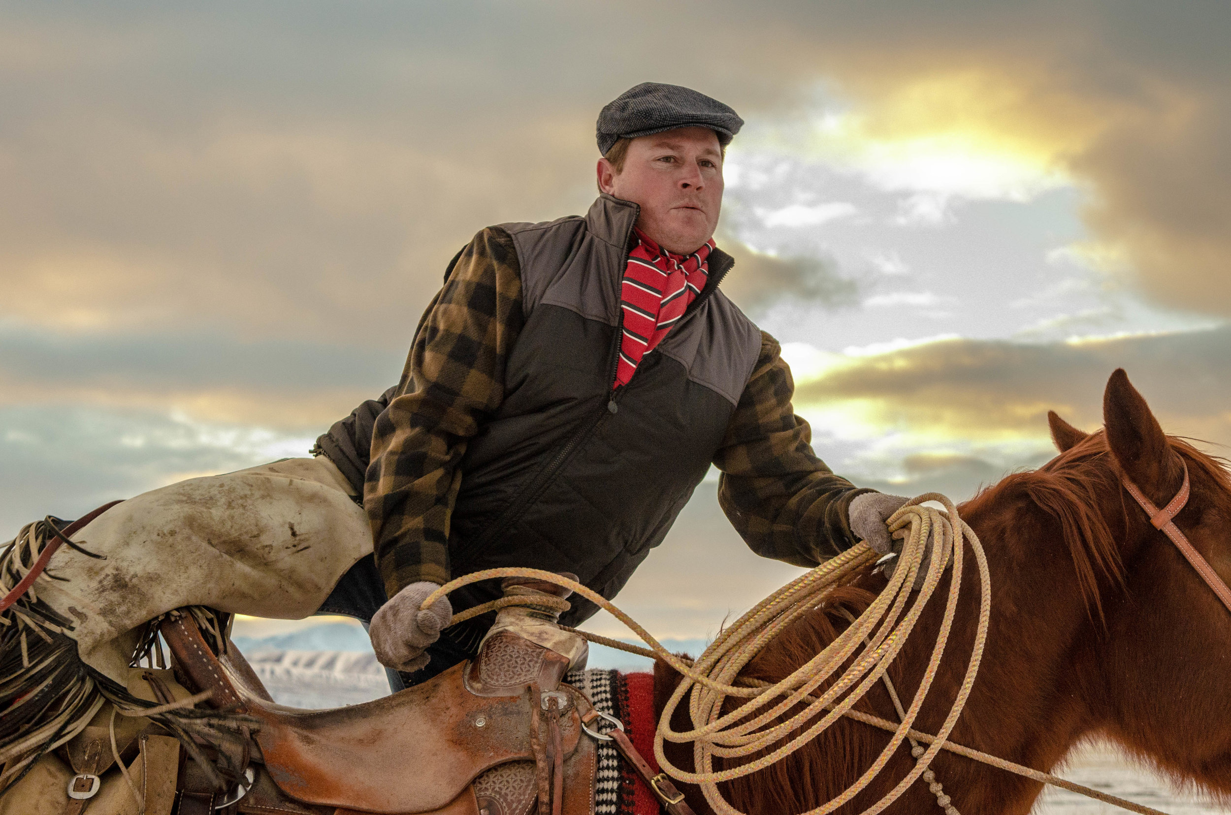 Cow Boss, Andrew Kromm, steps off to doctor a roped calf.  Clothing provided by Outback Trading Co, wild rag made by Plum Punchy Purdys, armitas by Saddle Tramp Leather (Andrew's business), saddle by Holstine Sadderly.