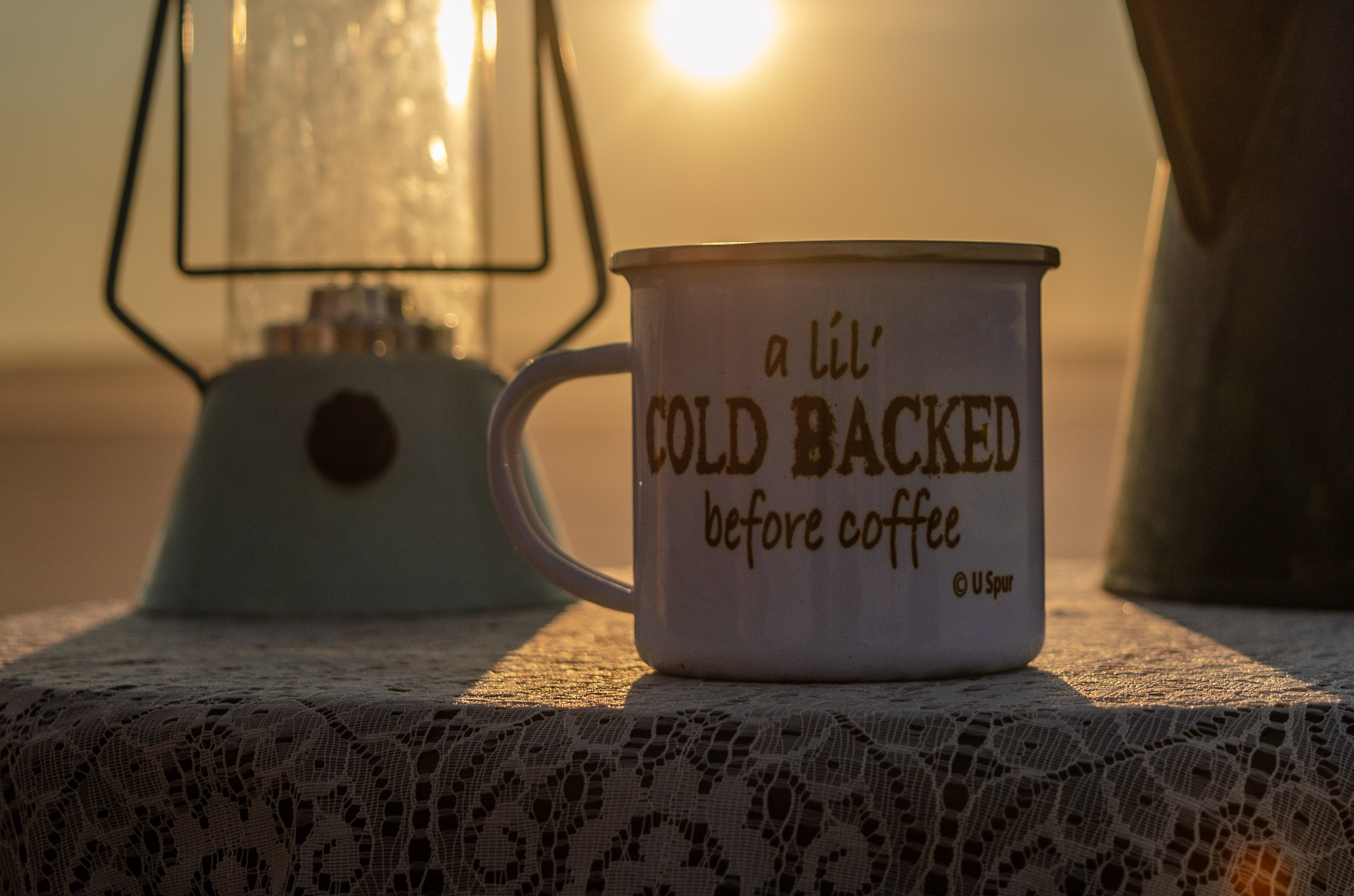 Product shot at sunrise on the Alvord Desert, featuring an enamel camp mug by U-Spur. If only we had some hot coffee on location!