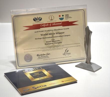 A FIABCI World Prix d'Excellence Awards díjátadón Heritage (Restoration / Conservation) kategóriában WORLD SILVER díjat nyert a Hotel Moments Budapest ****.Az Andrássy út 8. szám alatt megnyitott szálloda egy mozgalmas múltú műemléképületben kapott helyet, melynek tereit  Nagy Csaba vezetésével az Archikon csapata, míg a szálloda belsöépítészetét  Göde András vezetésével a  Kroki  Stúdió, az étterem belöépítészetét az  Este'r Partners gondolta újra. A projekt az  A8 Palace Hotel Zrt. beruházásában épült.