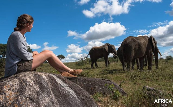 Sam's partner Vera with elephants in the reserve.
