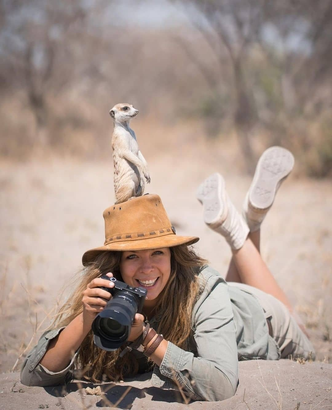 """""""Gesa was trying to get some eye level shots of the Meerkats when this individual saw an opportunity to get some height for a lookout post! Gotta love wildlife photography!"""" . Photo and caption from -  @safari.frank"""