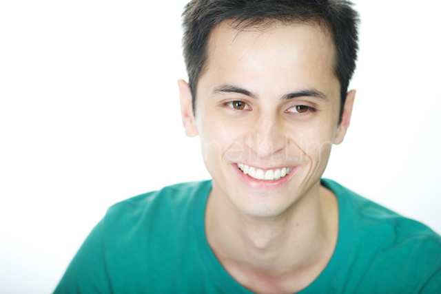 Hong Kong headshot portrait male smiling looking off white background