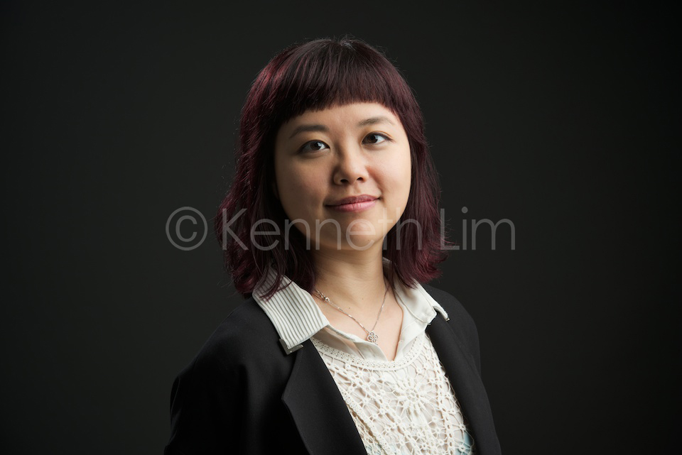 corporate headshot hong kong chinese female purple hair black background