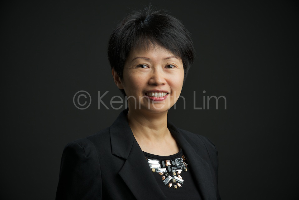 corporate headshot hong kong chinese woman smiling black background