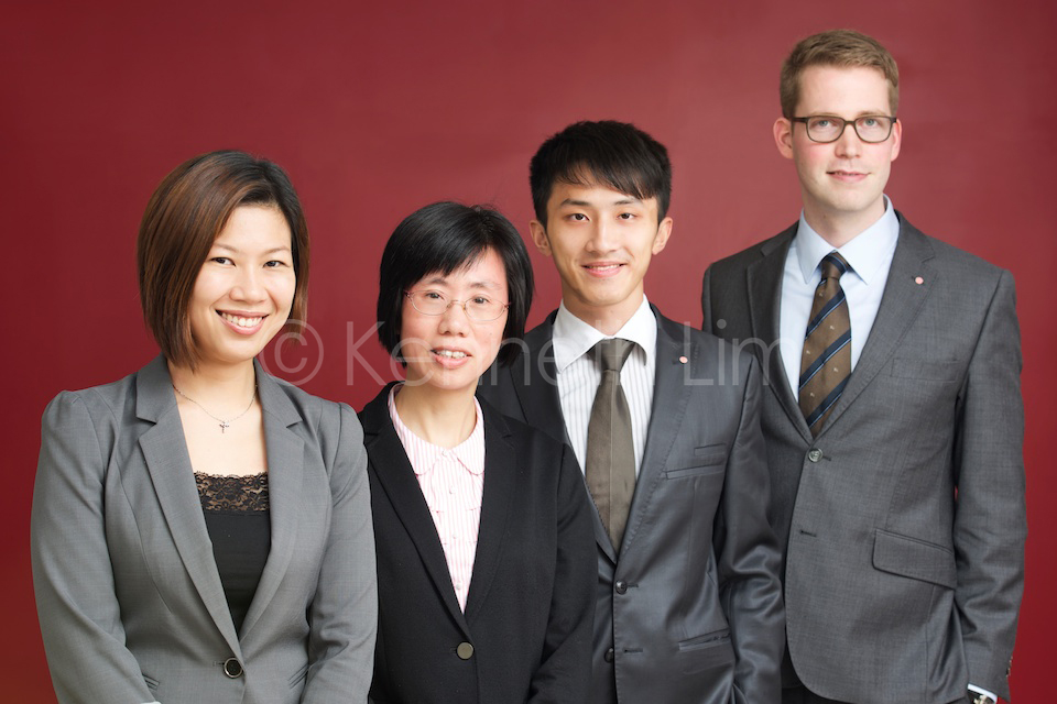 Group corporate headshots Hong Kong Central in front of red wall