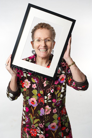Kay Ross holding a picture frame