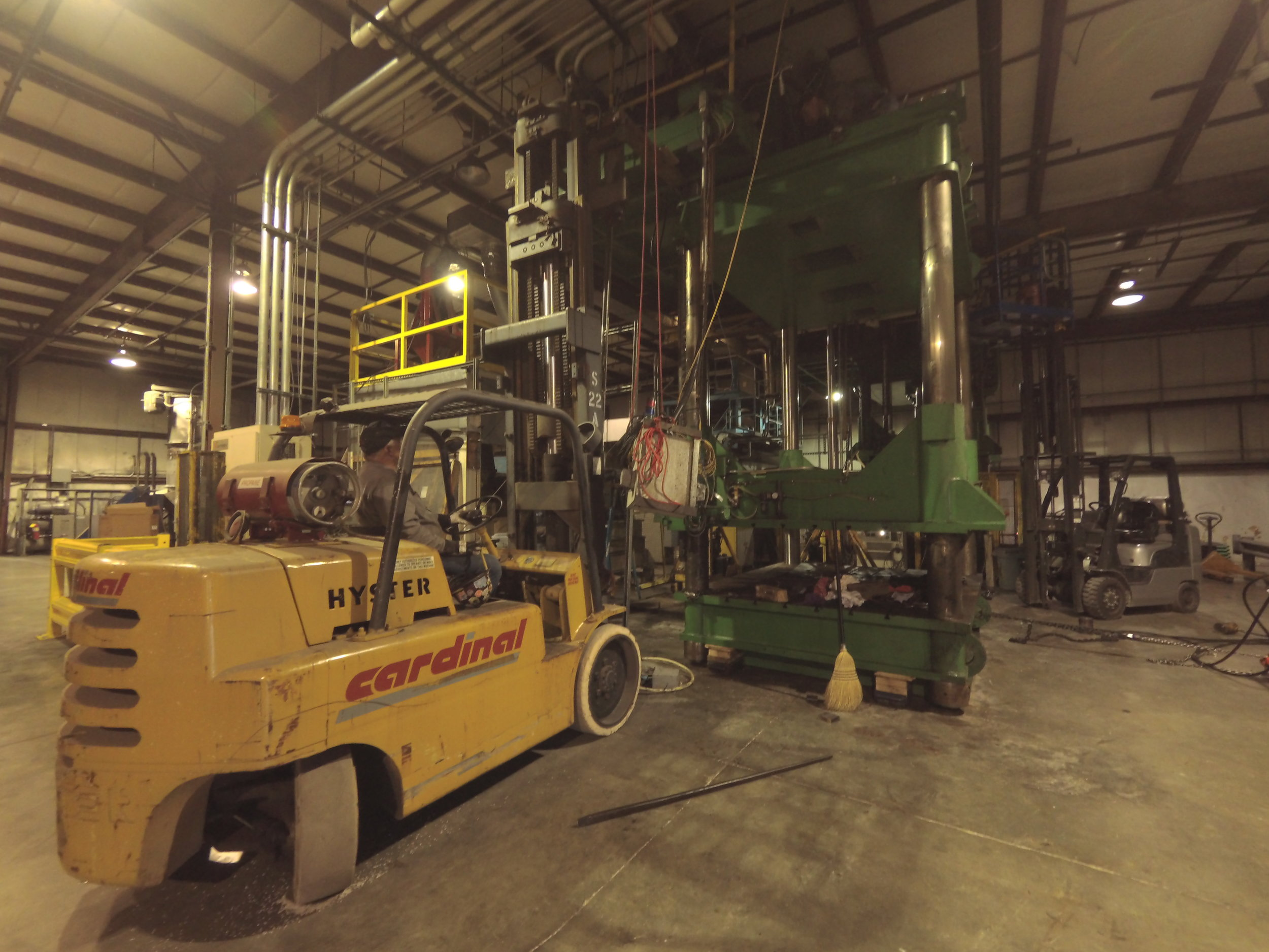 Perfect Pallet, 4/19/18 - We move and install presses, but did you know Cardinal Contracting also repairs presses? Four men, three forklifts, and a set of electric mini gantries disassembled, repaired, and re-stacked the press.