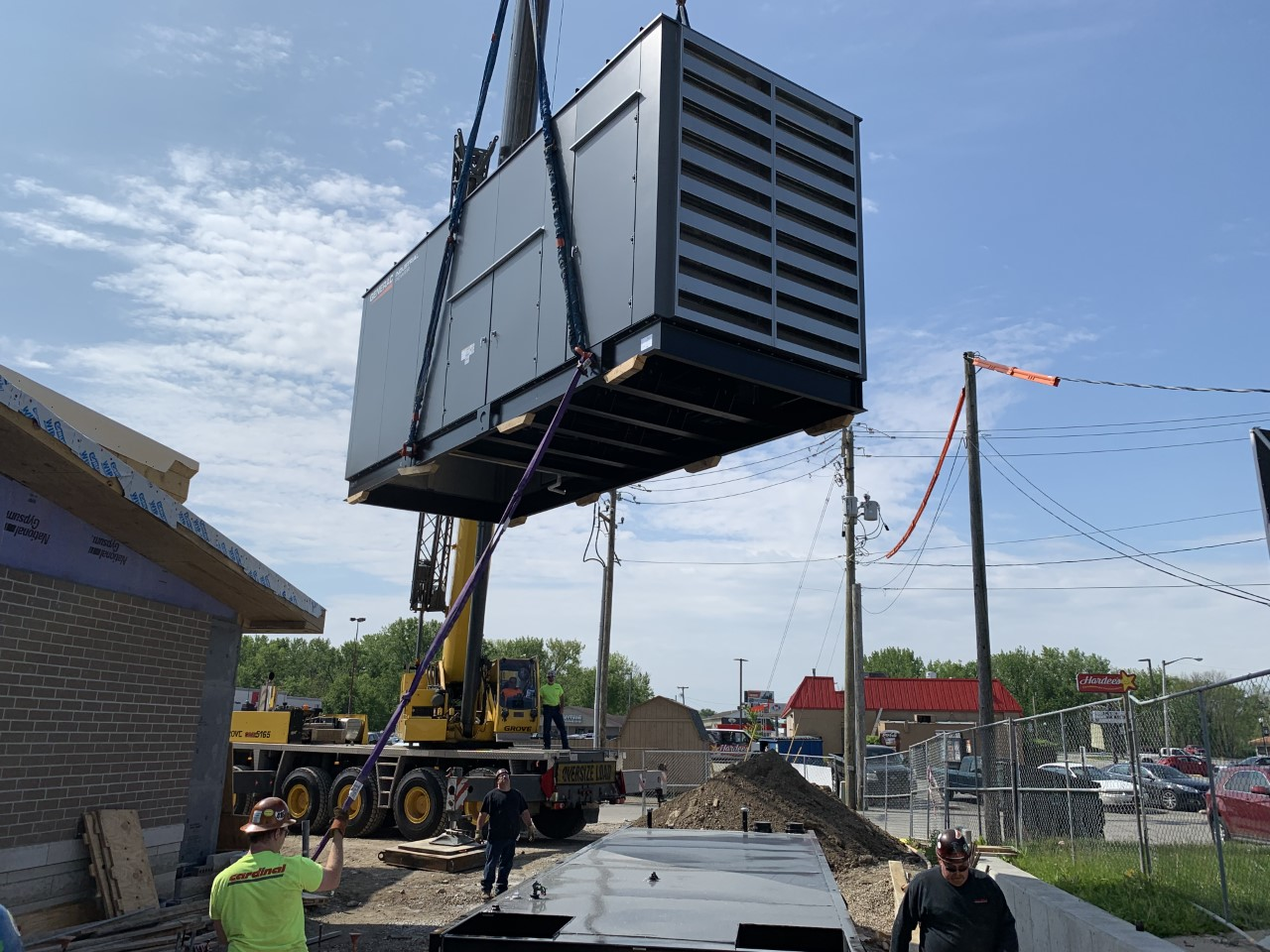 Banta Electric, 5/15/19 - Cardinal Contracting set a new Trane chiller and 40,000# Generac in Rushville, IN, and then got to work setting transfer switches and transformers in very tight spaces.It's tough to beat the efficiency and safety of 65 years in the rigging industry!