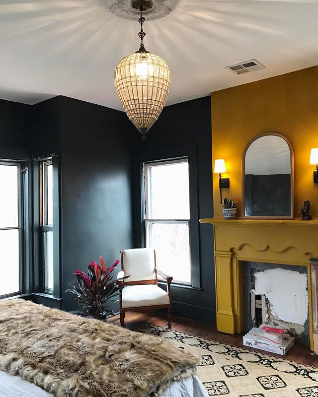 Our bedroom has come a long way. We still have a lot of work to do but I couldn't wait to share. I decided to go bold on the fireplace, and finally got our vintage chandelier hung! #interiordesign #masterbedroom #ihavethisthingwithcolor #thegreenhouse #homerenovation