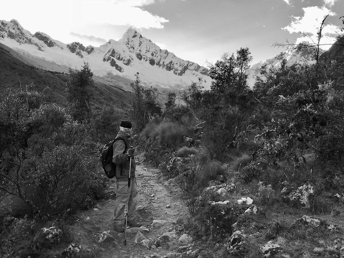 A plain path leads to Alpamayo Base Camp along the Santa Cruz Trek in the Peruvian Andes.