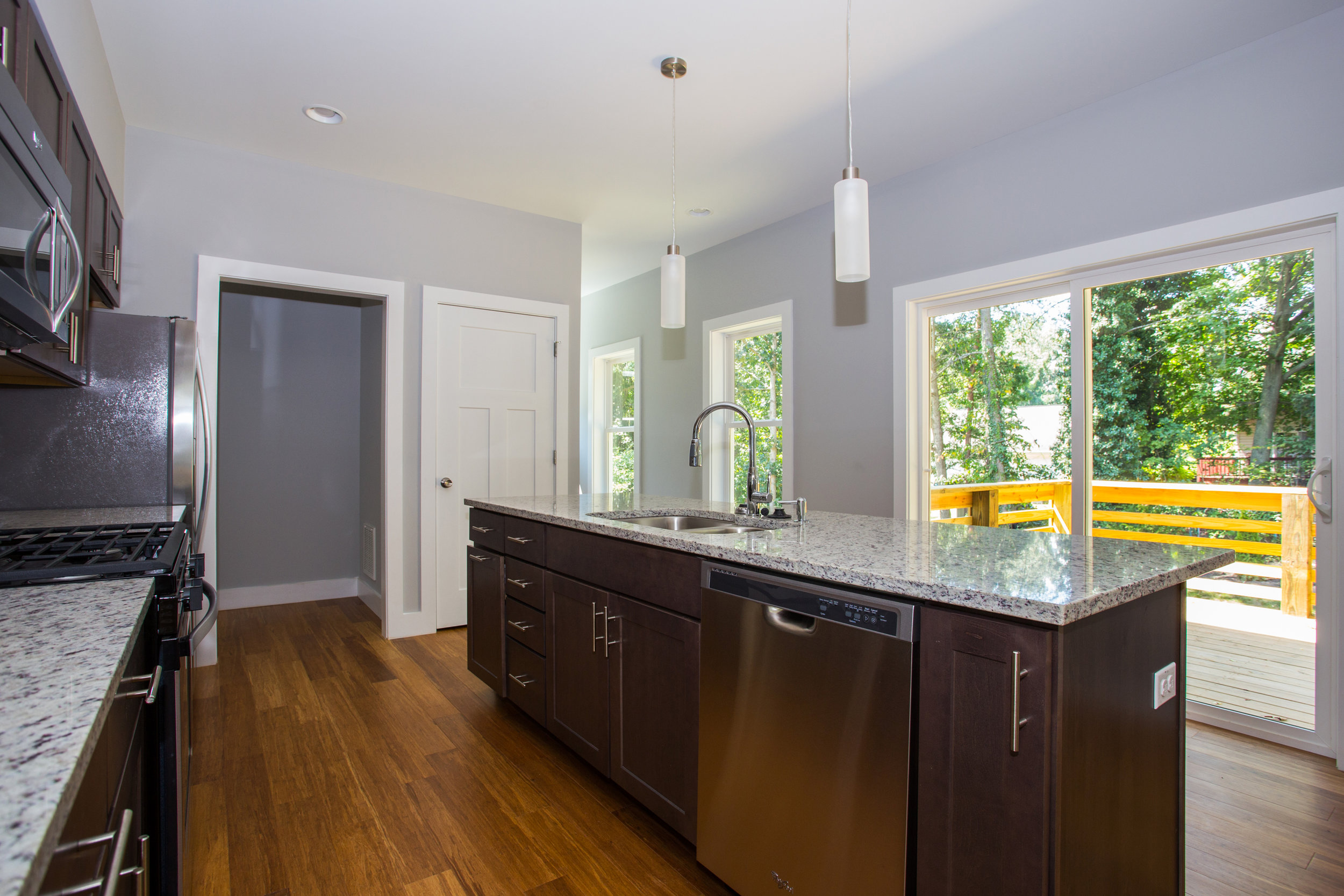 Kitchen/dining room opens to back spacious patio and private enclosure