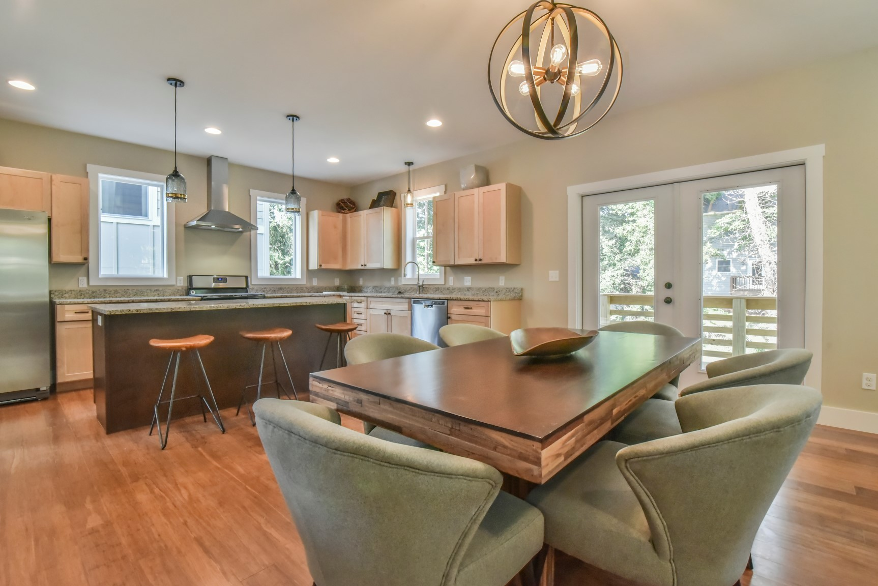 Kitchen/dining room opens to back spacious porch and private enclosure
