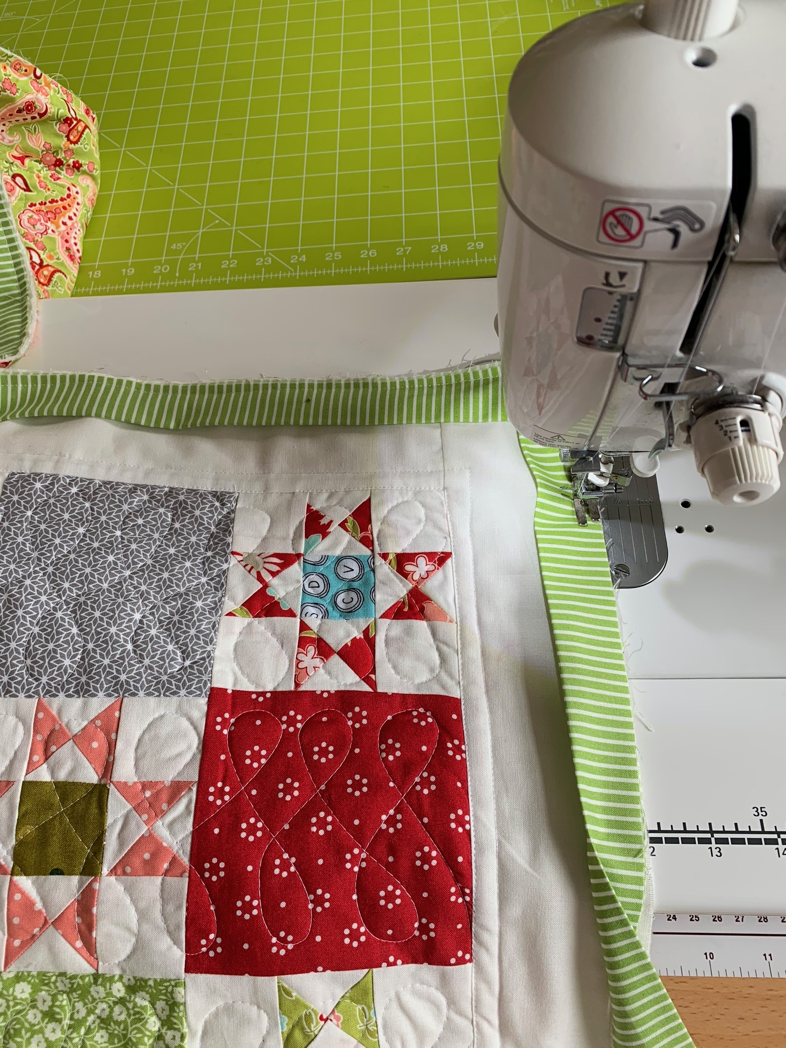 Free motion quilting scrappy quilt.jpg