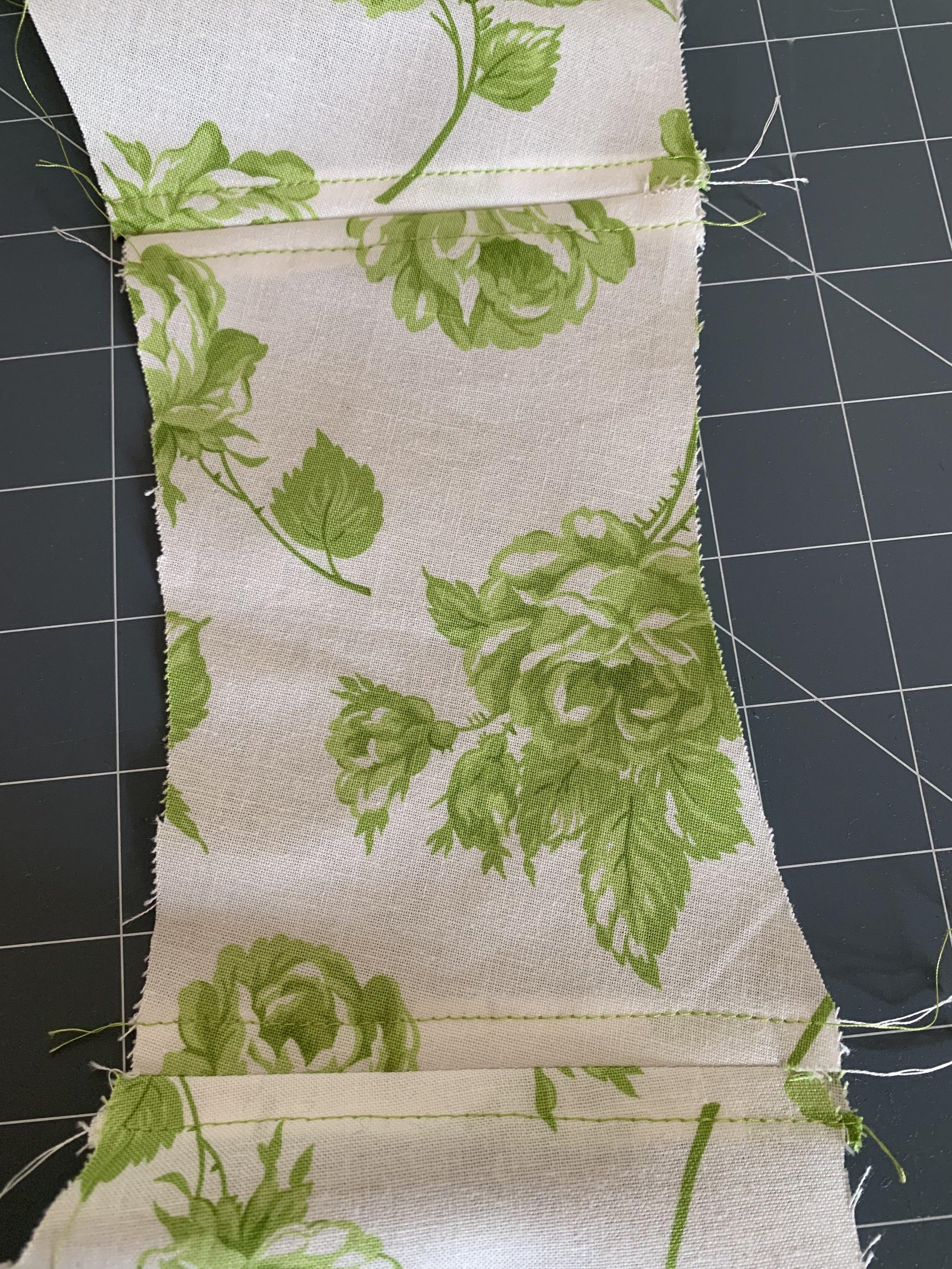 Top stitching on the peplum top.jpg