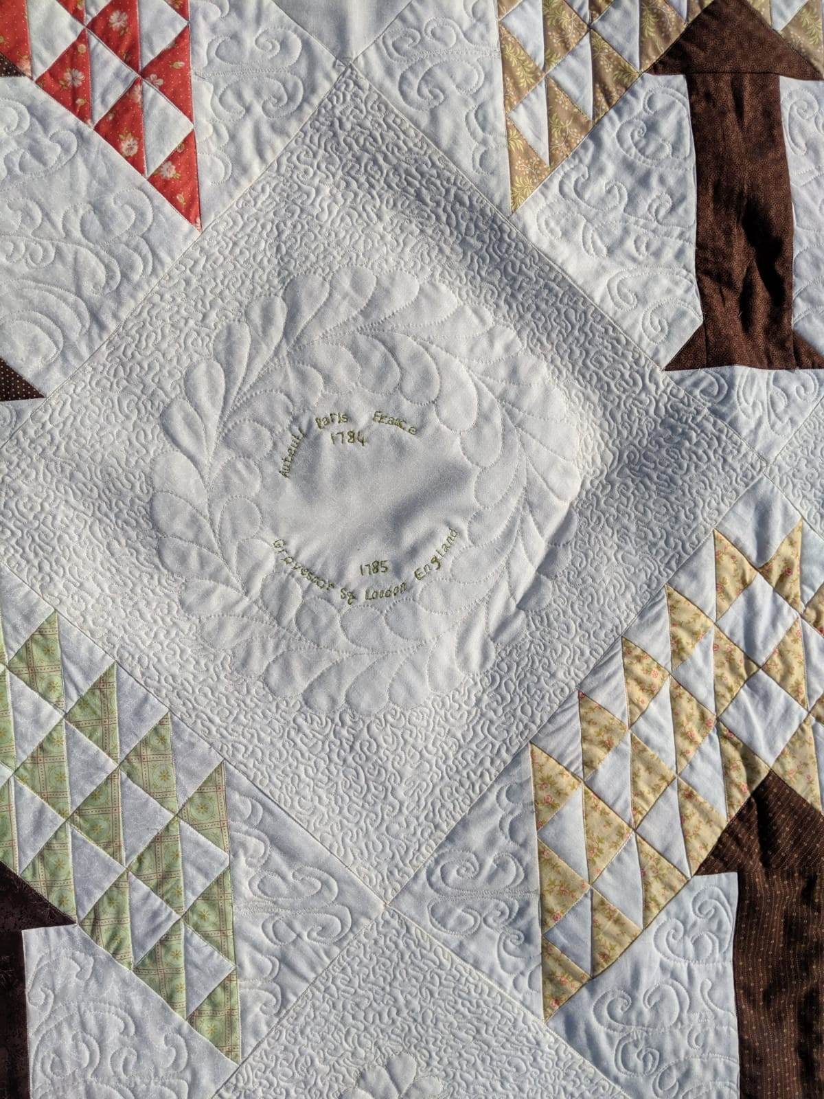 Hand quilted feathers.jpg