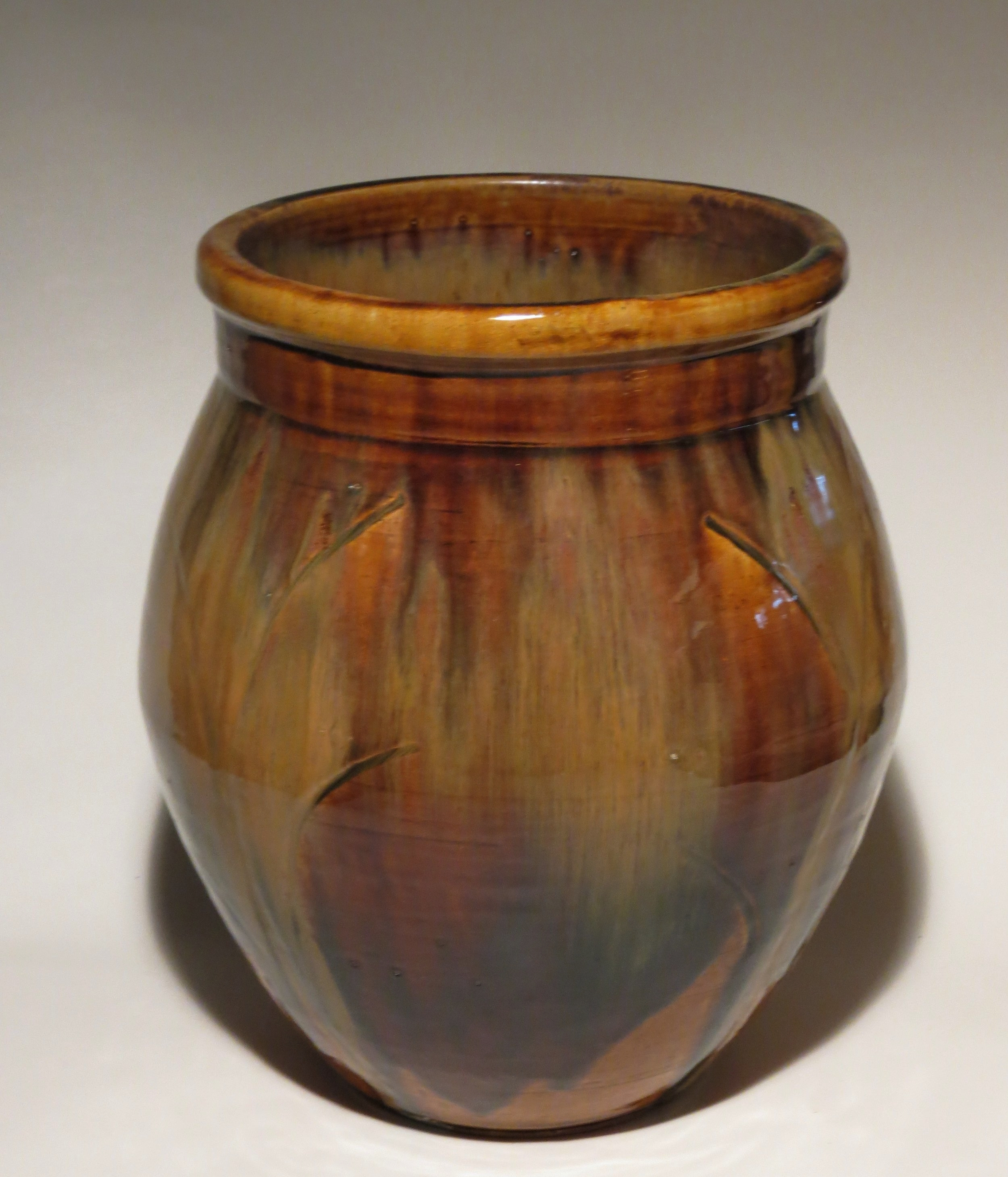 "Wood-fired stoneware planter. Tenmoku glaze with iron/rutile wash. 10x13""."