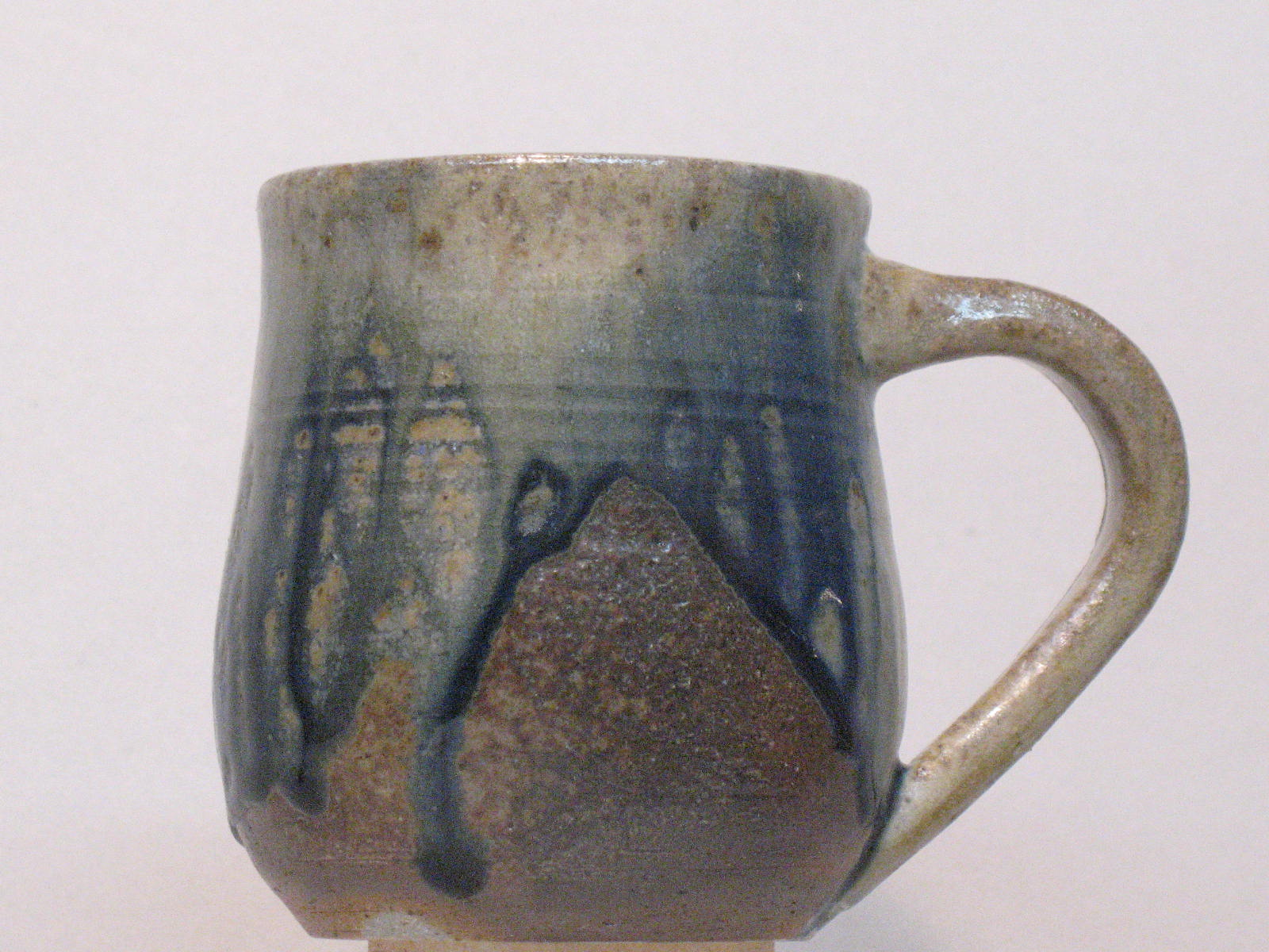 Wood-fired mug with cobalt ash glaze.