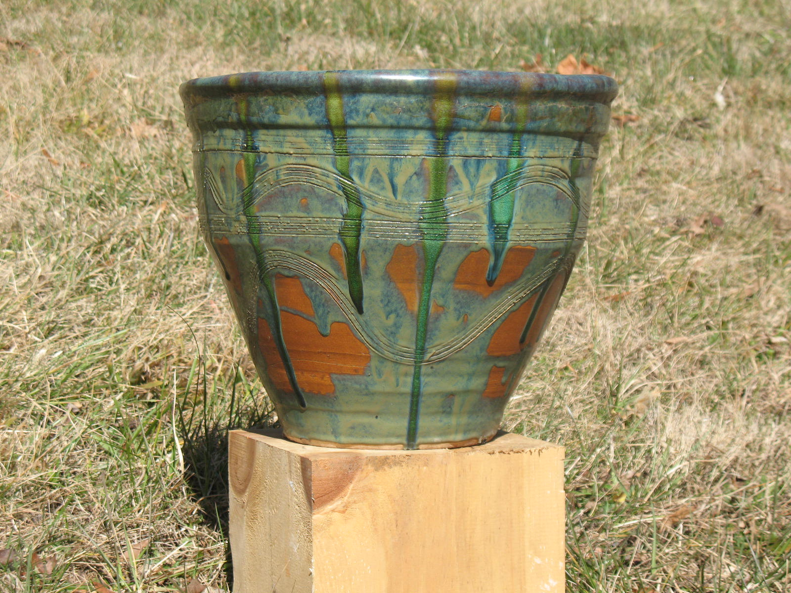 "Planter (14x16""). Floating green glaze with glass."