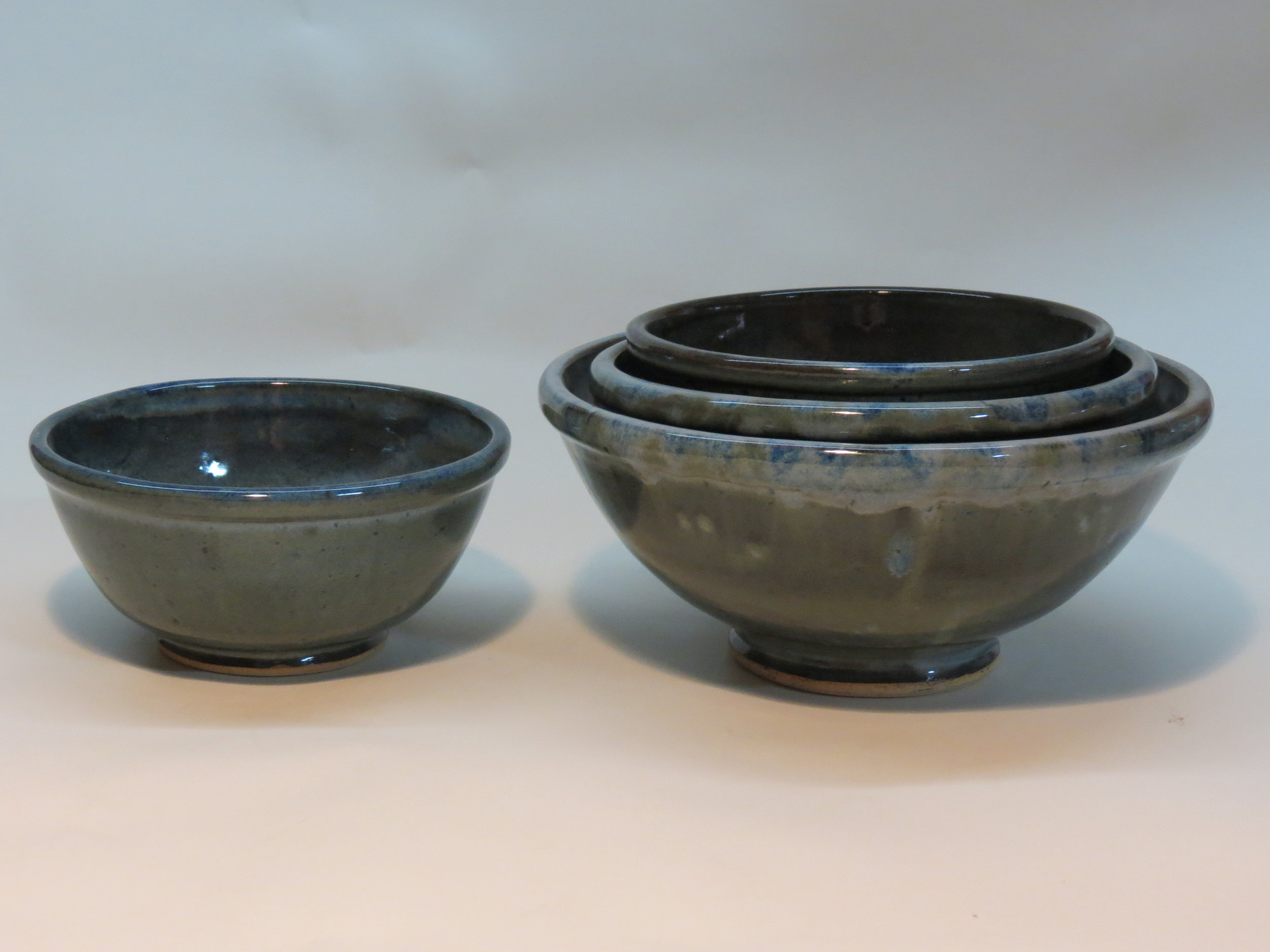 Bowl and nesting bowls with floating blue glaze.