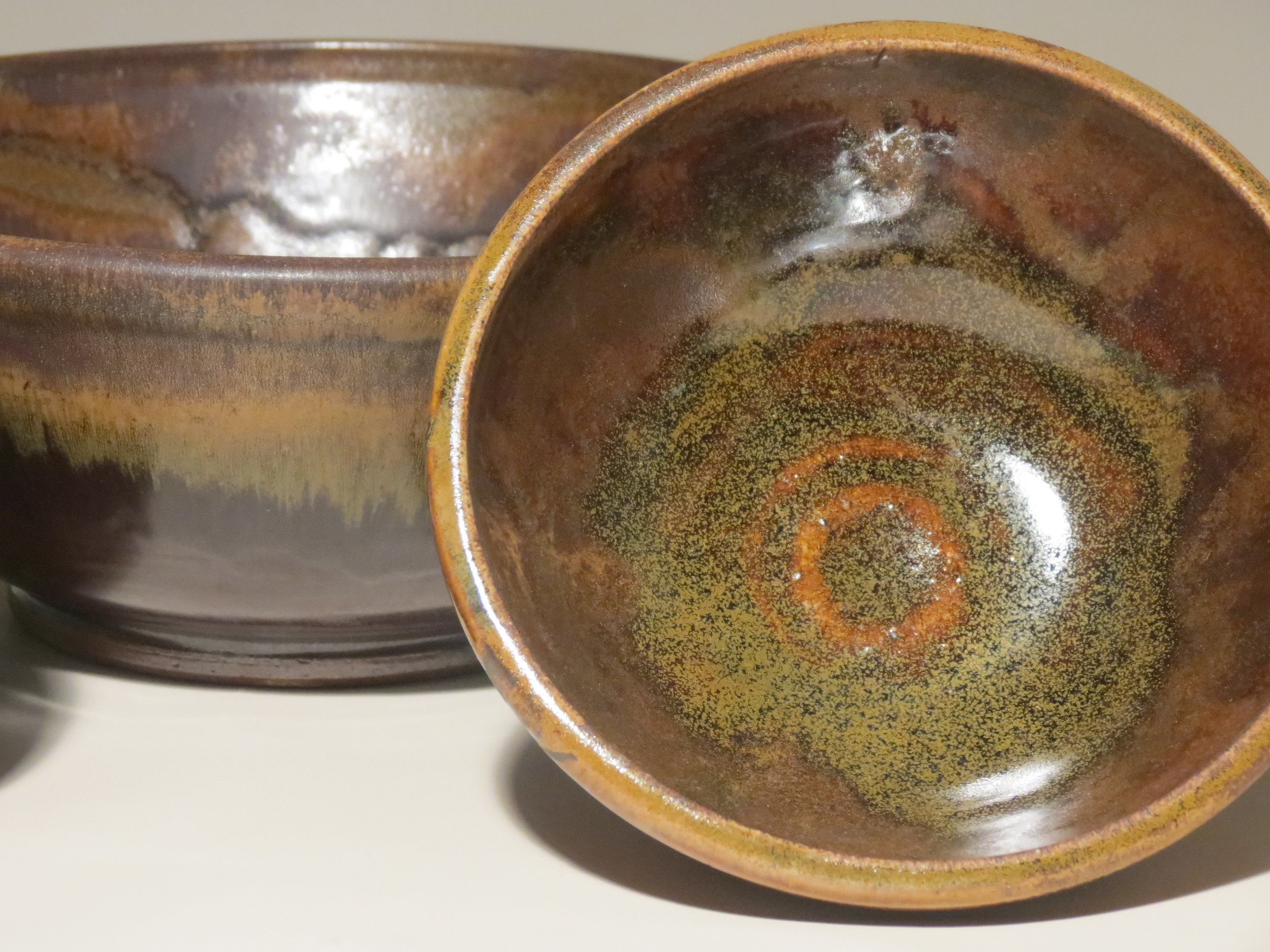 Wood-fired bowls with green salt flashing (frog skin).