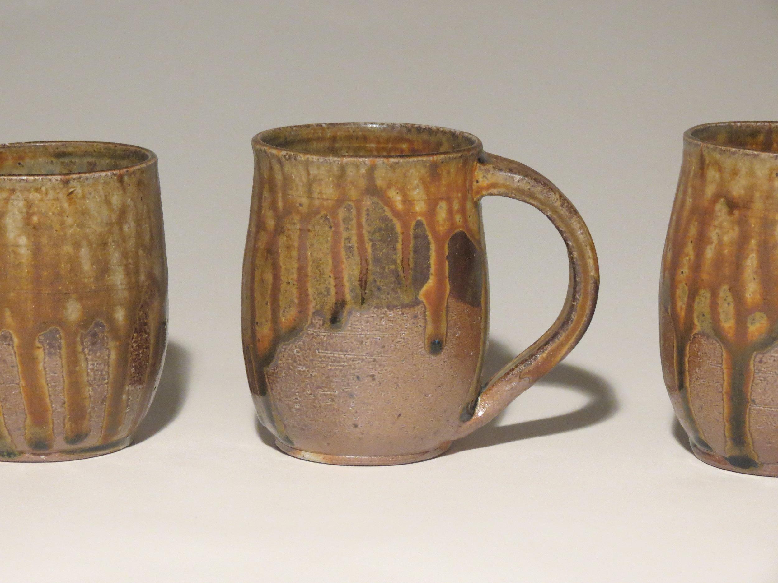 wood-fired mugs with ash and tenmoku glaze.