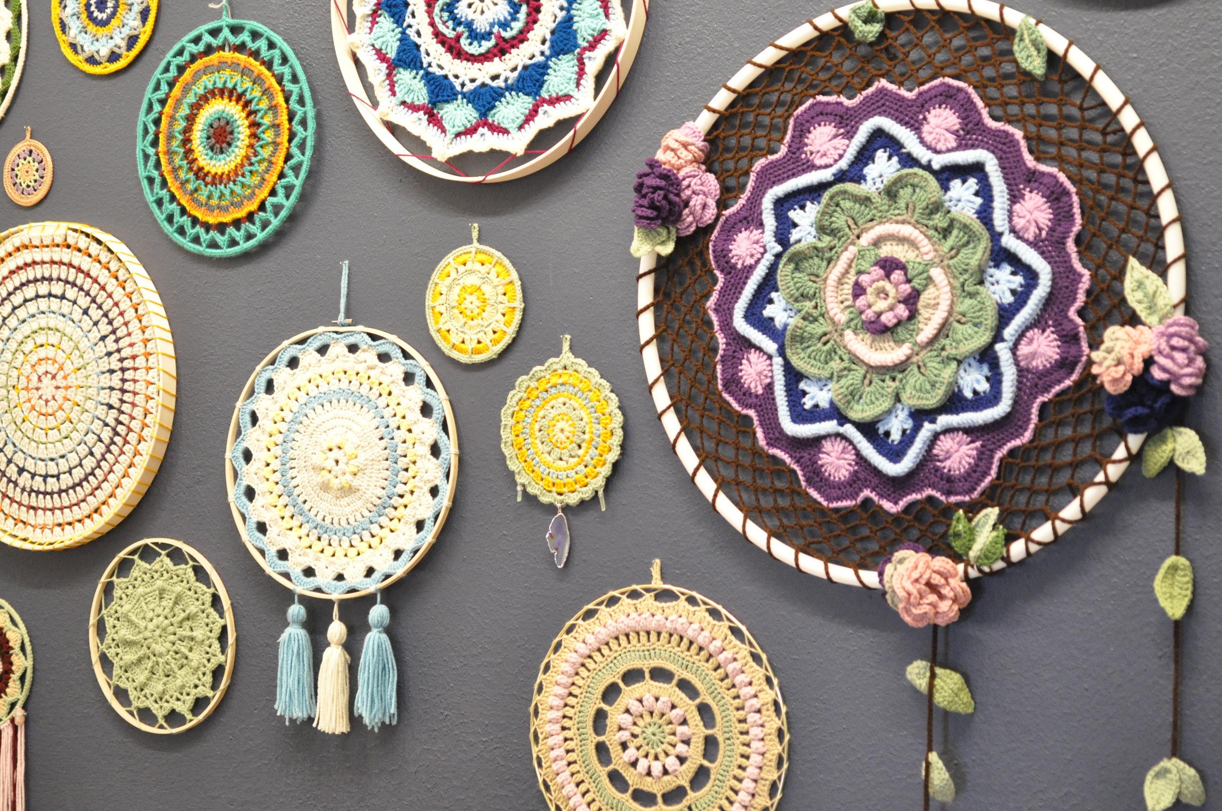 Earth Lotus Arts crochet mandalas up on the Indigo Wall
