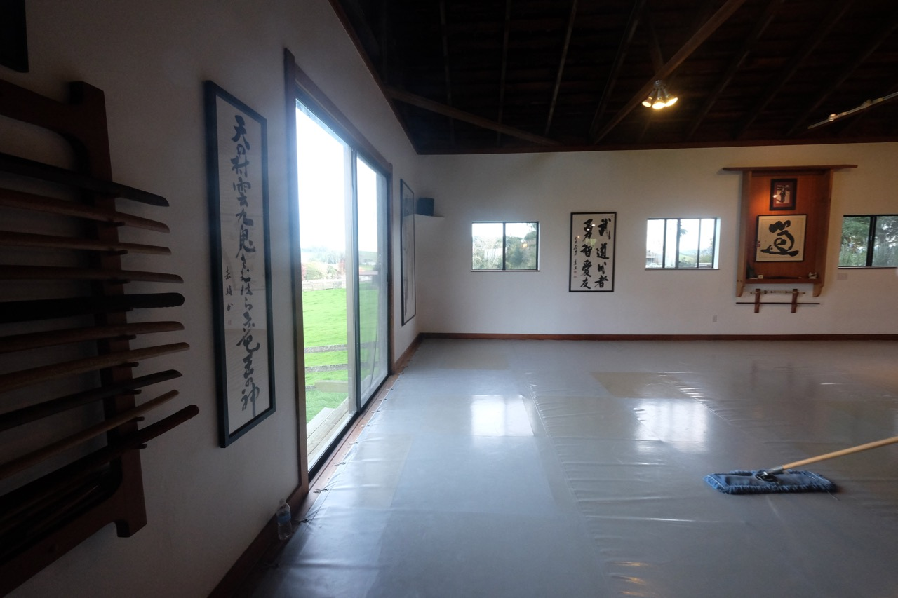 The dojo being cleaned by a student after our workshop ended, Strozzi Institute.
