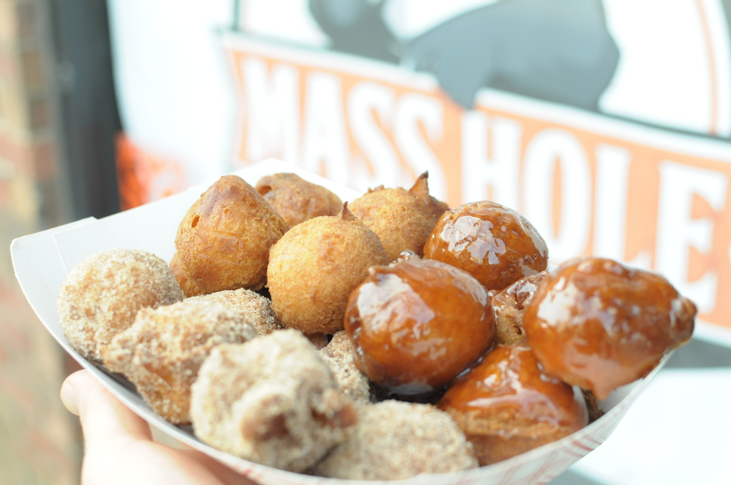 Our freshly fried apple cider Mass Holes: a New England tradition. Available plain, cinnamon sugar, or apple caramel.