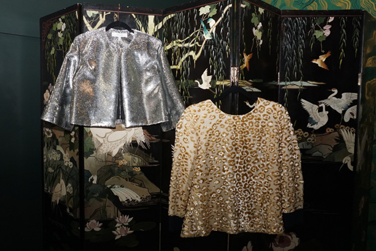 silver jacket and leopard print shirt