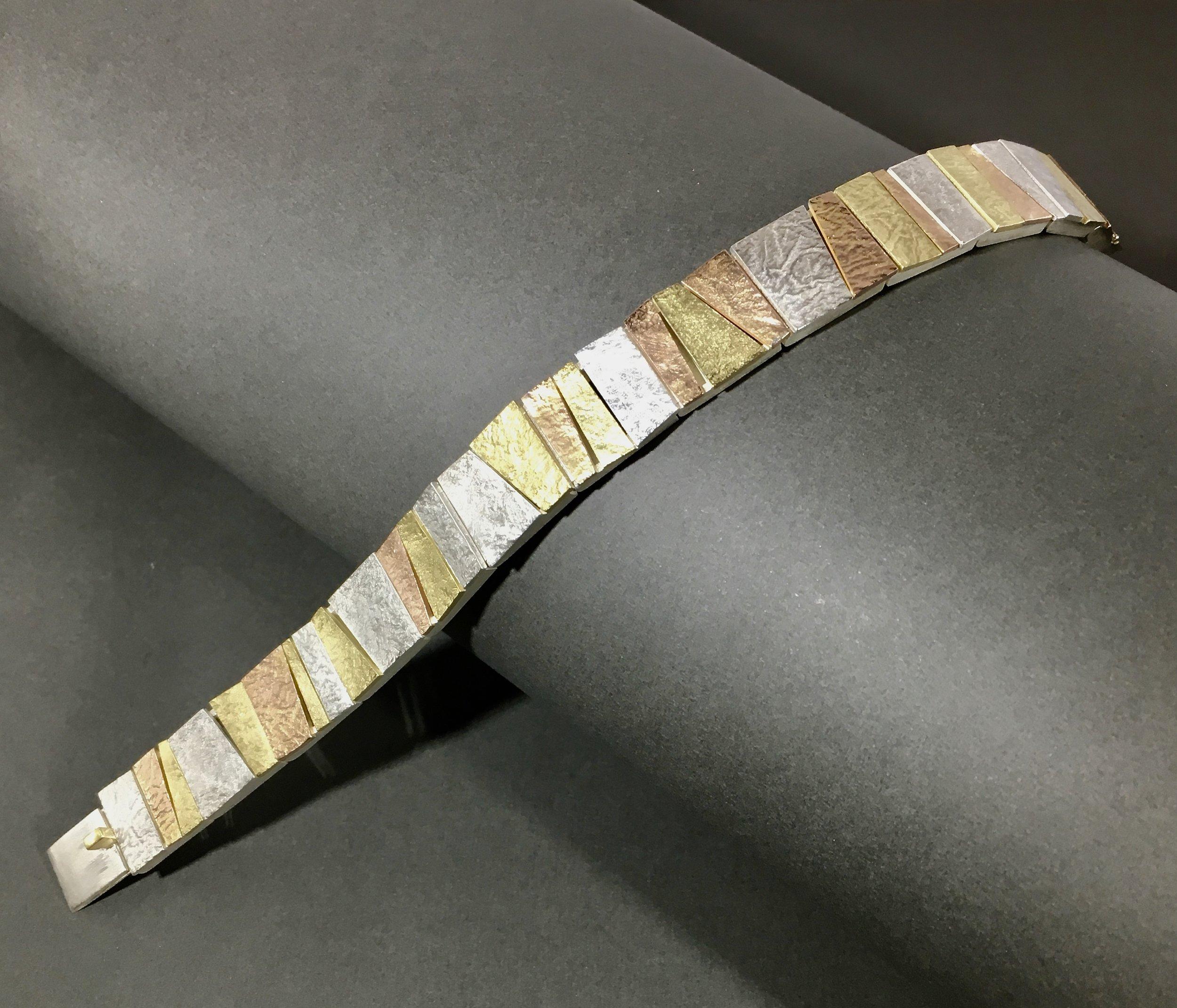 flexible link bracelet, multi colored gold, silver