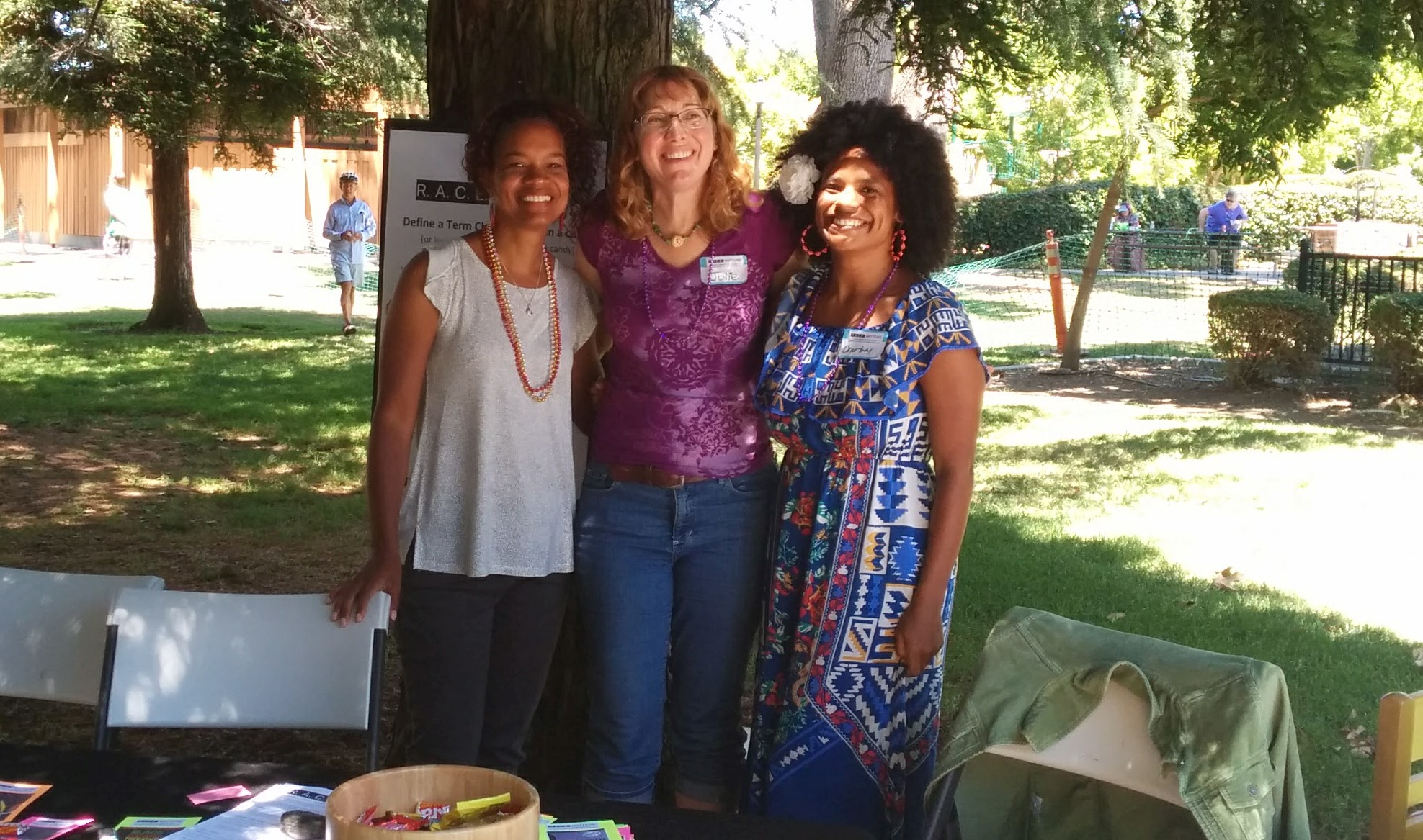 Julie Lynem, Julie Fallon, and Courtney Haile woman a booth at a SLO Progressives event in 2017.